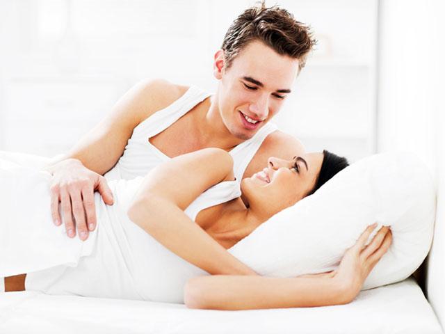 Happy couple in bedroom.