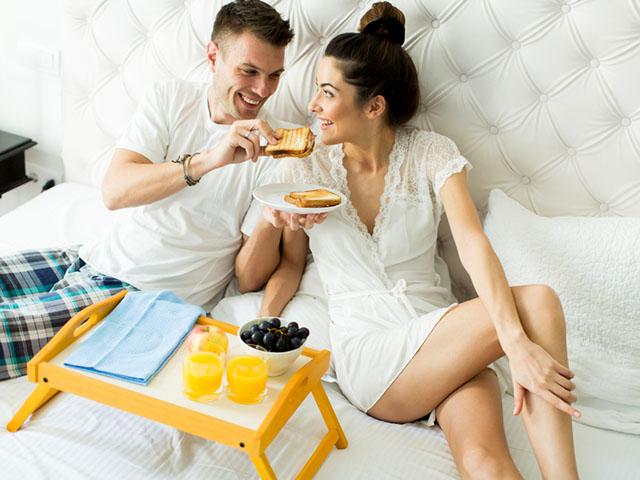 Couple having a breakfast in bed