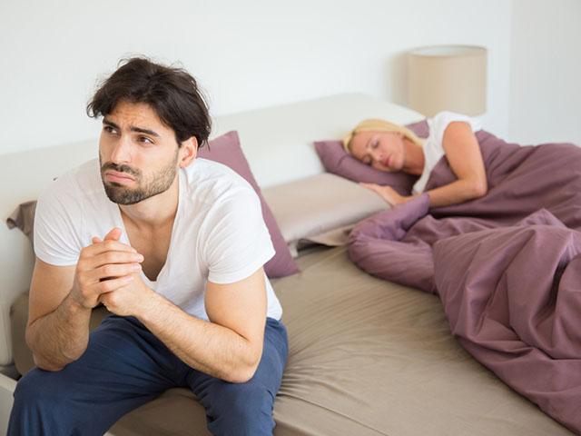 Unhappy young man thinking about break up .