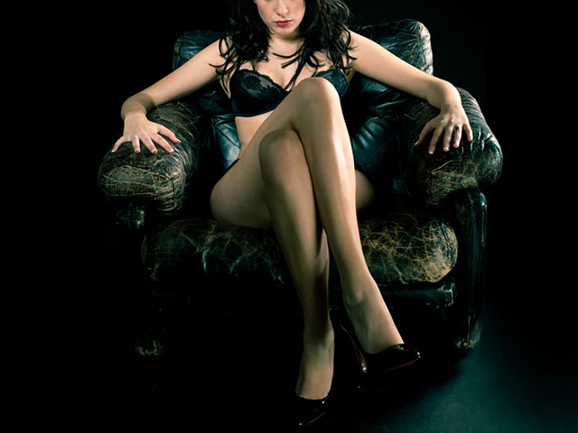 Glam beauty sitting over chair