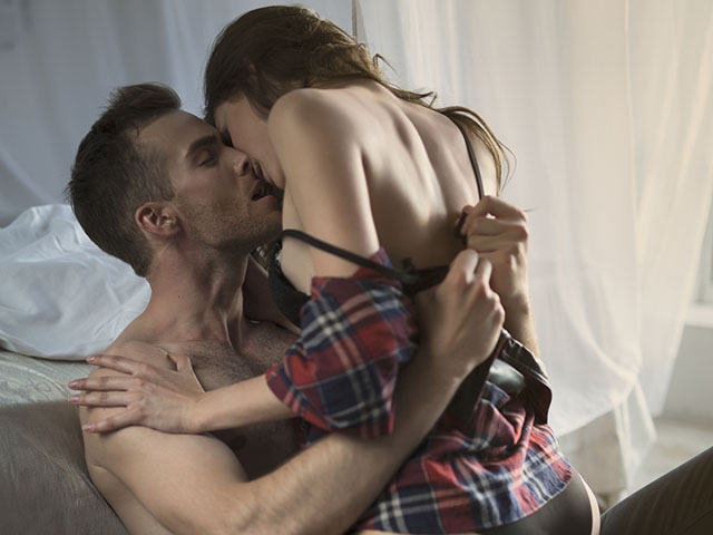 Passionate couple kissing